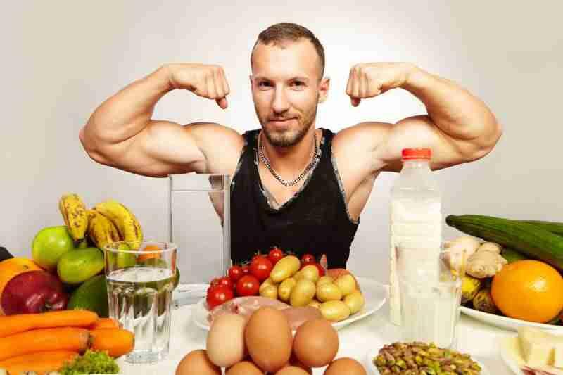 Bulking man eating a lot of food image
